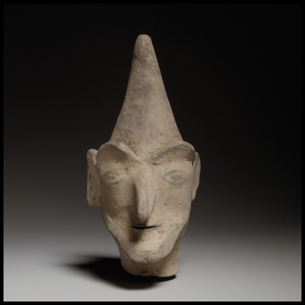 Male head wearing a helmet | Cypriot | Cypro-Archaic | The Met