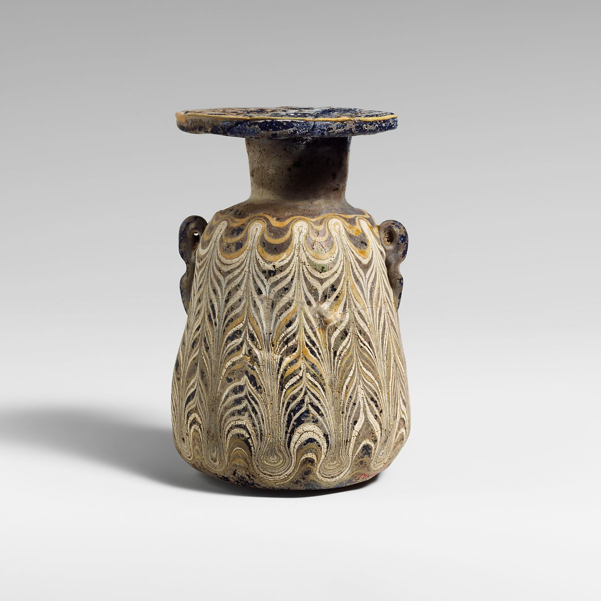 Glass squat alabastron (perfume bottle) | Greek, Eastern Mediterranean or Italian | Hellenistic | The Met