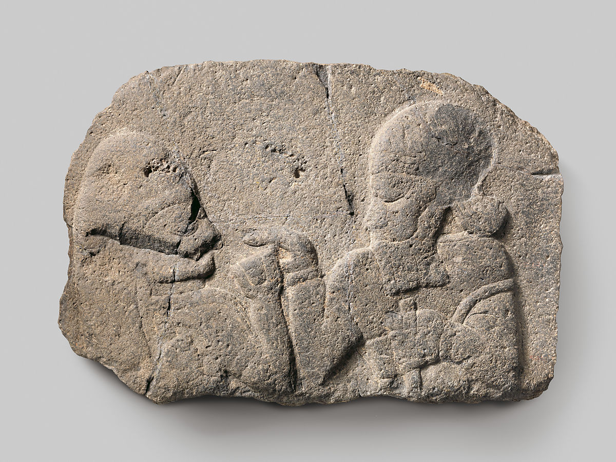 Neo-Hittite relief showing a man holding a cup for a woman