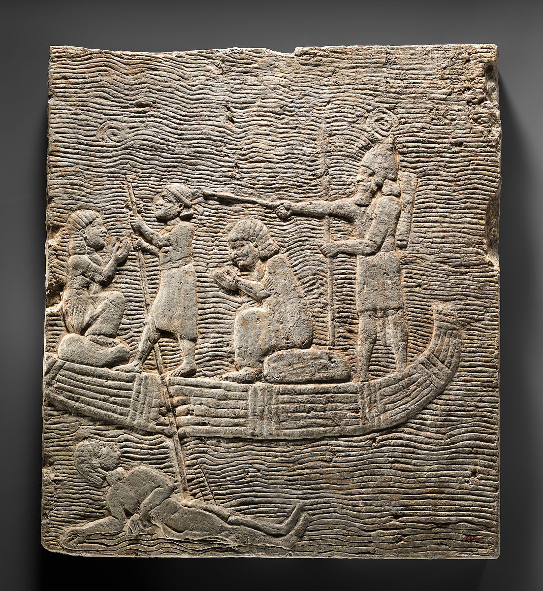 Relief fragment: Assyrian soldier conducting captives across the water   Assyrian   Neo-Assyrian   The Met
