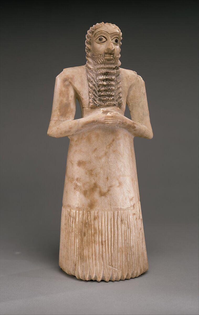Standing male worshiper, Gypsum alabaster, shell, black limestone, bitumen, Sumerian