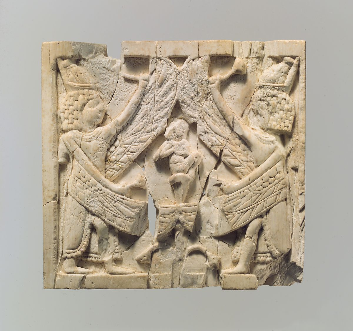 Furniture Plaque Carved In Relief Showing Two Winged Male Figures