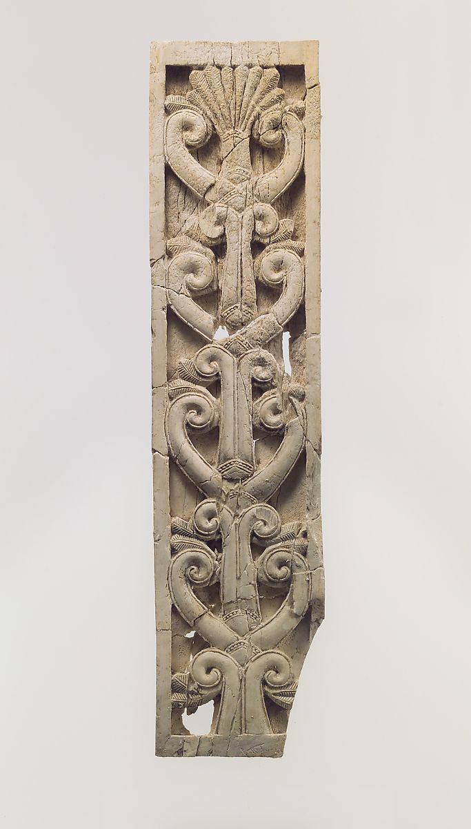 Furniture plaque carved in relief with volutes and a palmette