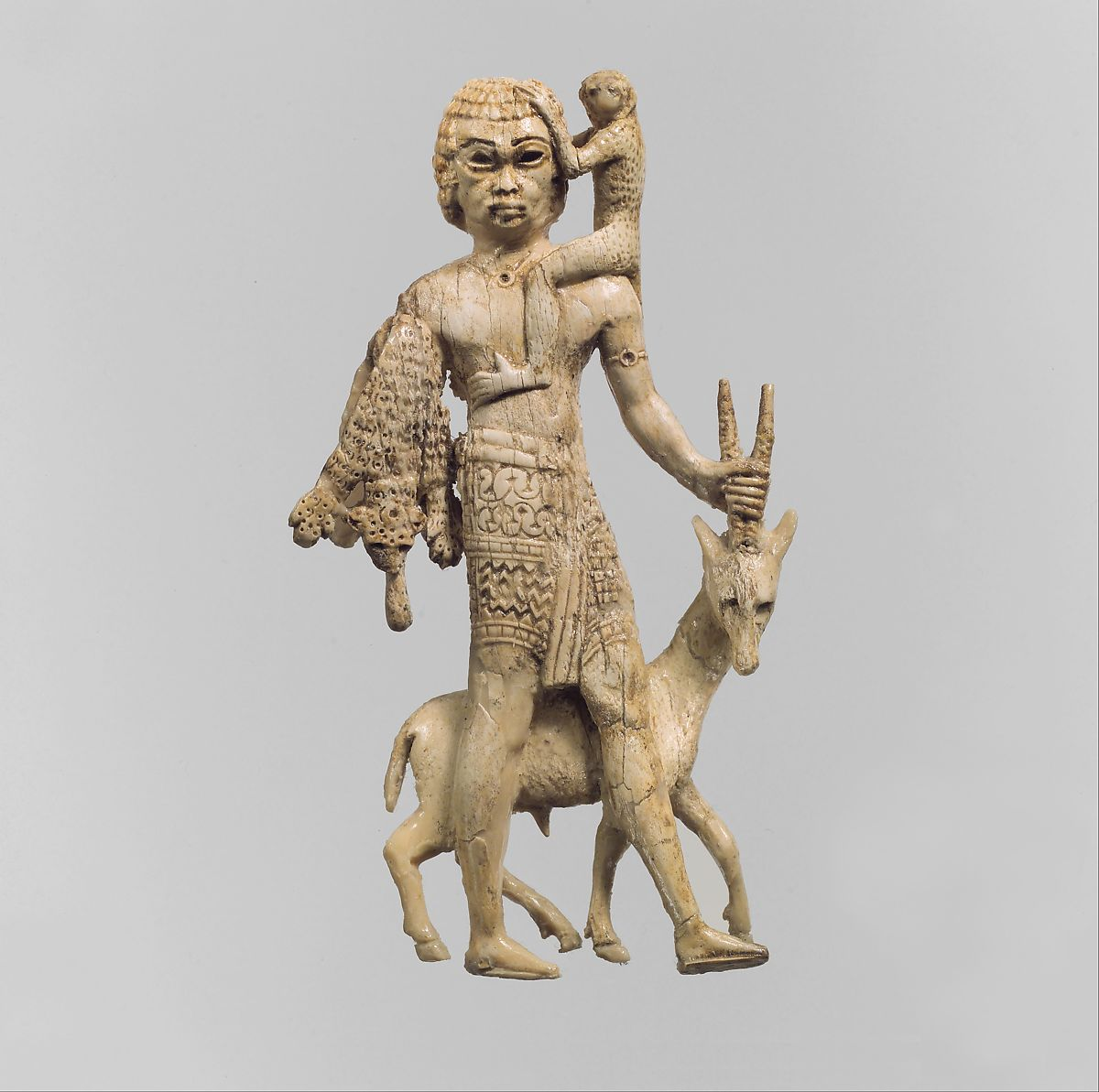 Statuette of a man with an oryx, a monkey, and a leopard skin, Ivory, Assyrian
