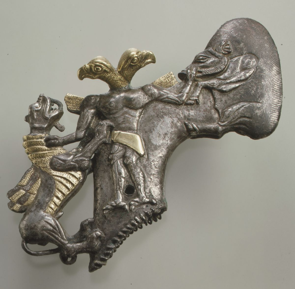 Shaft-hole axe head with bird-headed demon, boar, and dragon | Bactria-Margiana Archaeological Complex | Bronze Age | The Met