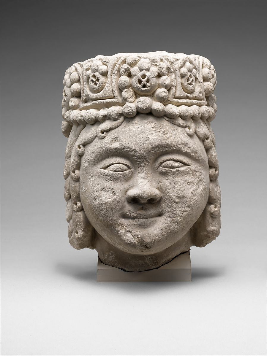 Head from a Figure with a Beaded Headdress, Fossiliferous limestone; carved, drilled