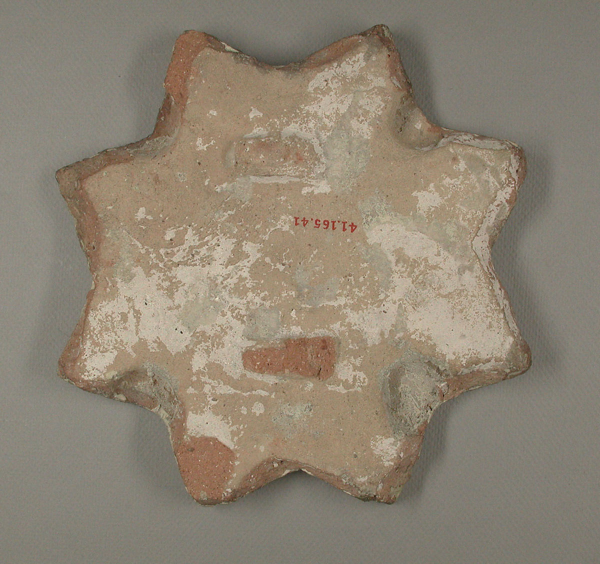 Star-Shaped Tile, Earthenware; luster-painted on opaque white glaze