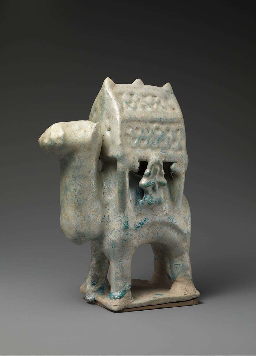 Turquoise Figurine in the Form of a Camel Carrying s Palanquin and Two Riders | The Met