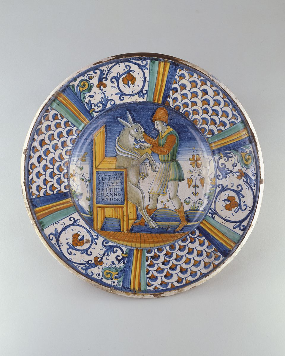 Dish (piatto): Man Washing the Mouth of an Ass, Maiolica (tin-glazed earthenware), Italian, Deruta