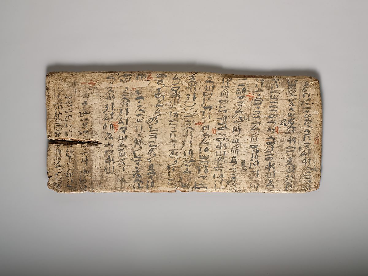 image of ancient African gesso write board with red ink corrections by teacher ca. 1981 B.C.E.
