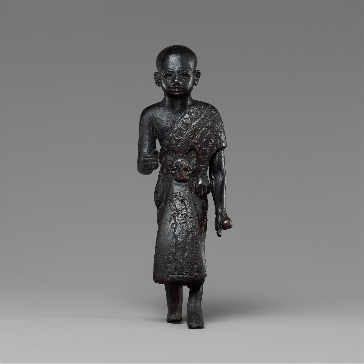 Priest in a leopard skin cloak with an inscription and Osiris on his skirt | Third Intermediate Period–Saite Period | The Met