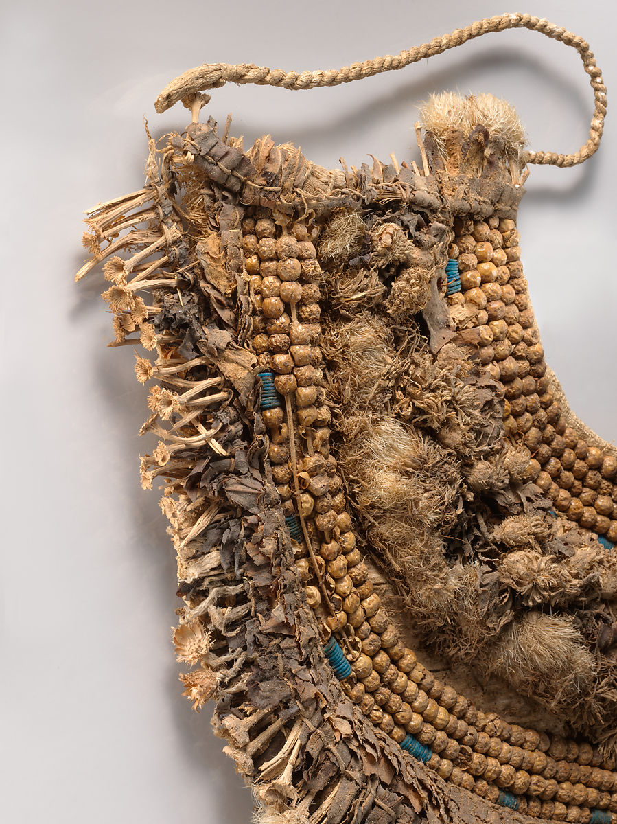 Floral Collar from Tutankhamun's Embalming Cache, Papyrus, olive leaves, persea leaves, cornflowers, blue lotus petals, Picris flowers, nightshade berries, faience, linen