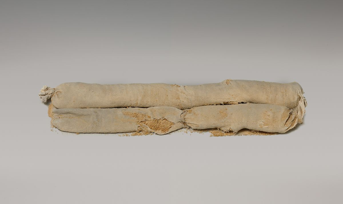 Cylindrical Bag Of Sawdust From Tutankhamun S Embalming Cache Linen Decomposed Wood Material