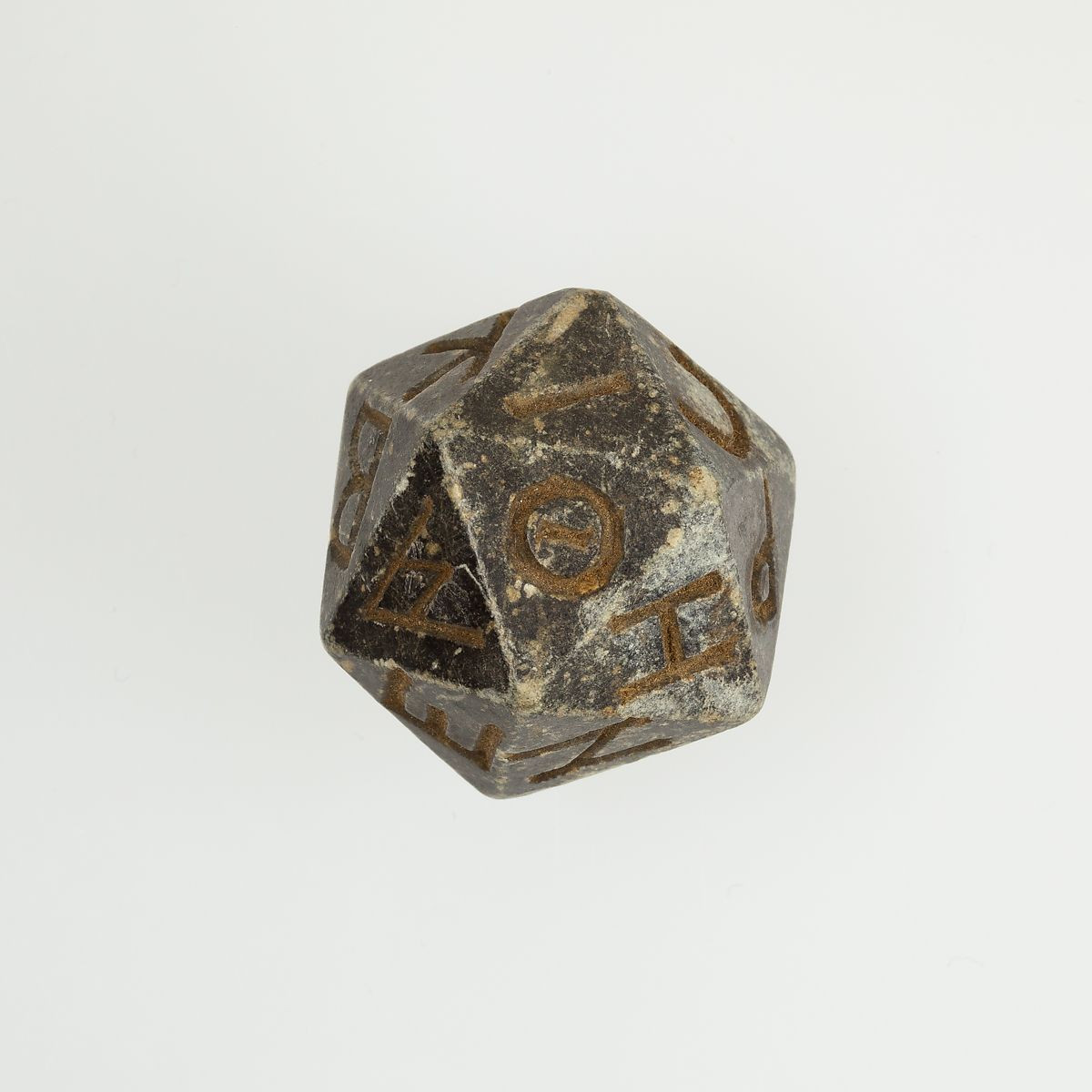 Twenty-sided die (icosahedron) with faces inscribed with Greek letters | Ptolemaic Period–Roman Period | The Met